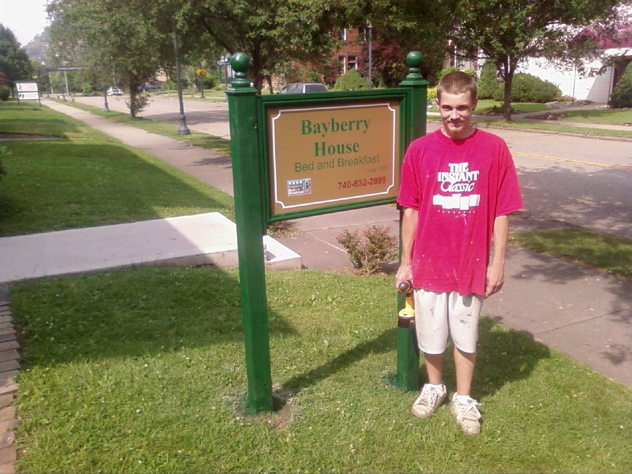 My son Derek after he got the sign put up.